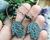 HAMSA a pair of silver and howlite stone metal intricate scrolled open hand earrings