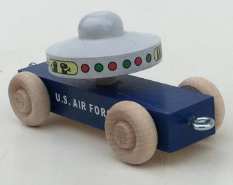 U S Air Force.  USAF Wooden Toy Train UFO transport car.  With flying saucer and ETs (extraterrestrials).