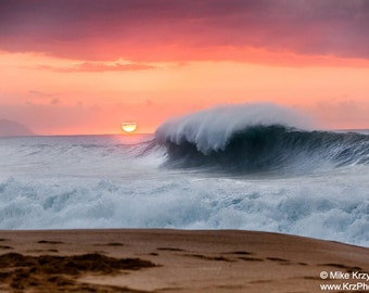 Big Wave Breaking Under an Orange Sunset on the North Shore of Oahu in Hawaii