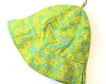 60s bucket hat, green daisy print, side pocket with zipper