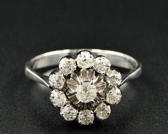 A charming Art Deco 1.10 Ct diamond unique daisy ring