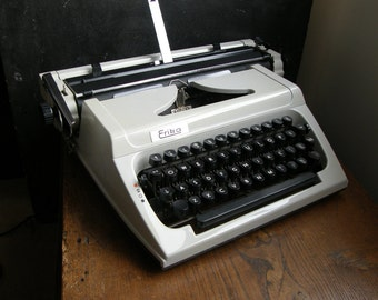 1970s,white,black Erika Manual Typewriter, fab carrying case , working with new ribbon fitted,Good condition, Free uk postage