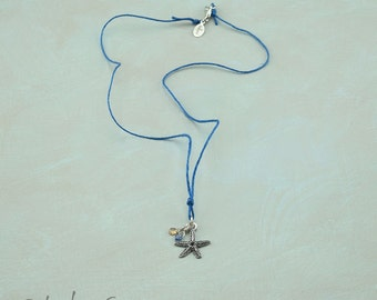 Sterling Starfish Necklace with Sapphires on Linen