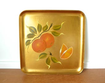 Hand painted oranges on gold leaf alcohol resistant tray