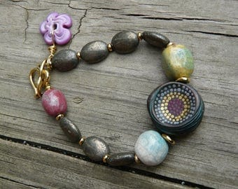 Pyrite and dots bracelet.  Beaded bracelet with handmade ceramic and polymer clay and lampwork beads.  As seen in Jewelry Stringing