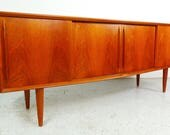 HOLD mid century Danish modern teak long low curved front credenza by H.P. Hansen with slide doors