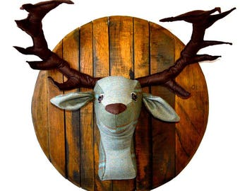 Large tweed stags head mounted on a whisky barrel lid