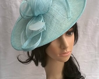 Aqua Feather Fascinator..Stunning shaped Fascinator on a Headband..