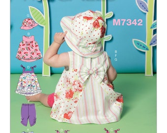 M7342 Infants' Back-Bow Dresses, Panties, Leggings and Bucket Hat Sewing Pattern, New Uncut, Size Nbn-Sml-Med-Lrg-Xlg