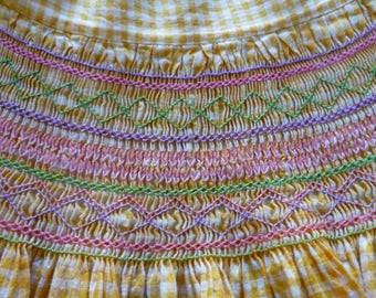 1960s hand smocked apron ~ home sewn vintage childs apron