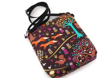 Zippered shoulder bag cross body purse: foxes trot whimsical cotton print. Adjustable strap. Chocolate brown and orange.