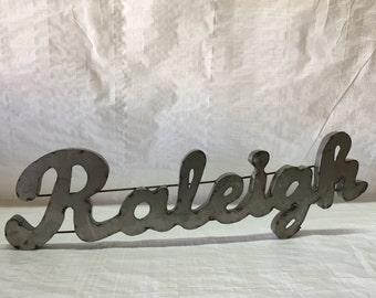 Metal Raleigh Sign
