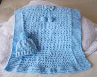 Hand knitted babies blue crib/pram blanket and hat set