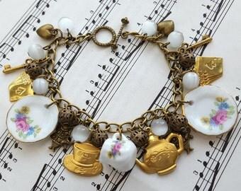 Alice in Wonderland bracelet, tea party theme, teapot, white rabbit, key charms, vintage inspired china plates, bronze chain
