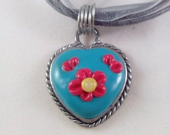 Blue and red flower necklace in silver tone bezel, polymer clay pendant