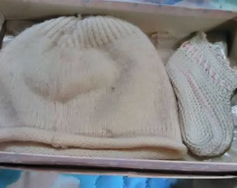 Baby knit hat and booties.  Booties have pink ribbon to tie booties.