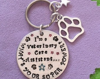 I'm a Veterinary Care Assistant / Animal Care Assistant - Fab Funny Keyring Gift. Vet Nursing. With paw & star charms.