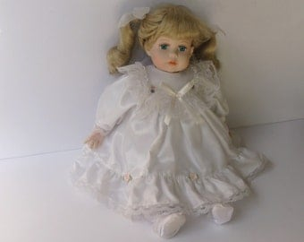 Doll Collectors, Vinyl Doll, Doll in White Satin Dress, May Rich Imports, Vinyl Doll with Blonde Pig Tails, and Blue eyes