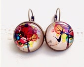 Earrings , asymmetric, cabochon, tree of life in the colored circles and the black cat.