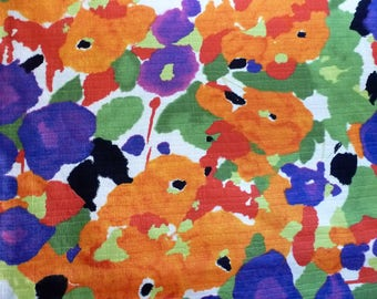 A bright, painterly, medium scale 100% cotton print fabric with a linenlike slub texture. One piece of 2 1/2 yards plus at 60 inches wide.