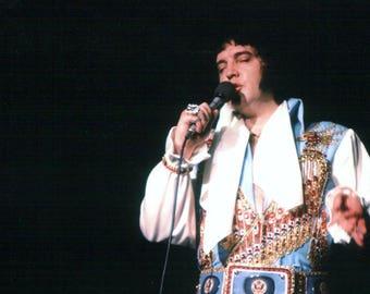 Elvis Presley ,   Elvis singing on stage 1970's