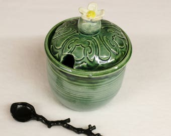 Soft Green Water Sugar Jar with White Flower Lid and Lake County Diamonds Canister