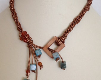 14 in copper leather choker with shell, faceted carnelian and turquoise colored jasper