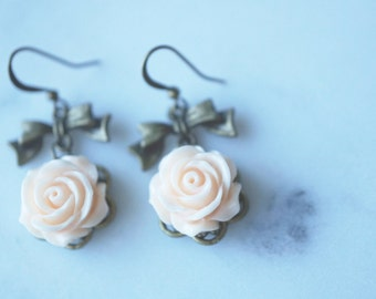 Earrings, shabby chic blush pink resin rose and bow dangle earrings