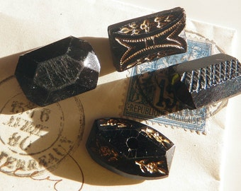 4 Oblong Victorian Black Glass Buttons Gold Trim Incised Carved Cut Designs