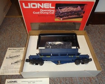 Lionel electric trains, A side dumping coal car with unloading tray ,coal,and control