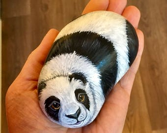 Giant panda painted pebble rock art