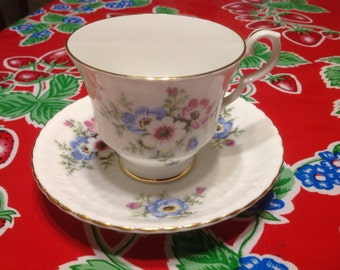 Vintage Royal Windsor Fine Bone  China tea cup and saucer with floral designs- England