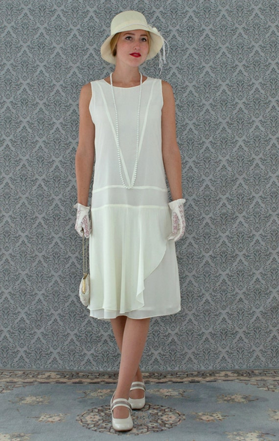 1920s Style Dresses, Flapper Dresses Cream chiffon flapper dress with a ruffled skirt detail cream Great Gatsby dress 1920s flapper dress high tea dress 1920s wedding gown $130.00 AT vintagedancer.com
