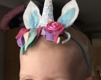 Unicorn headband. Fits age 18 months to 4 years