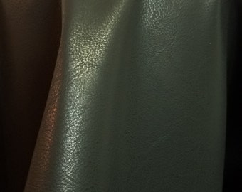 Black Faux leather matte Pleather sold by the yard 36 inches x 52 inches wide Synthetic for one yard.  1 yard- 5 yards
