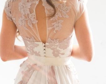 Milk silk wedding dress with flowing skirt