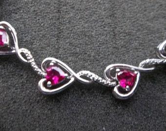 Sterling Silver 925 heart bracelet w/ Ruby stones