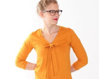 "Dress ""Lore"" with decorative bow / / saffron"