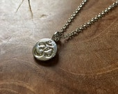 Tiny Ohm - cute necklace with a little round Ohm sign. silvertone, cute, modern, trendy, yoga, boho, bohemian, trend, fashion, zen