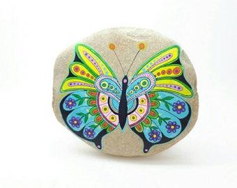 Mandala stone. Painting on stone. Adriatic Coast. Butterfly. Italy.