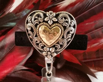 Make a Statement.  This piece is bold and it speaks to you.  A chic hammered metal badge holder that gets you seen.