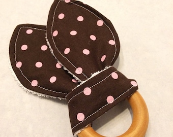 Eco friendly wood teething ring with brown and pink polka dot fabric