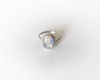Moonstone ring,sterling silver, twisted wire halo, size 5US