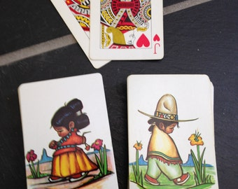 Latino Little Boy and Girl Playing Cards