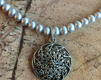 Silver metal pendant with fresh water pearls necklace.  Adjustable.