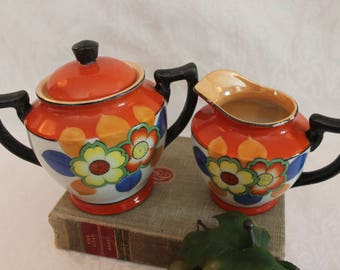 Vintage Orange and Black Porcelain Sugar and Creamer Set with Bright Flowers - Made in Japan