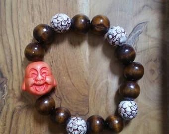 Wood beaded stretch bracelet with smiling Buddha
