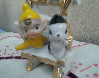 Vintage Pixie / Elf and Skunk on a chair Figurine kitsch Yellow pixies Elves