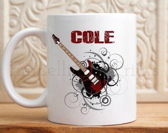 Guitar 11 ounce ceramic coffee mug.