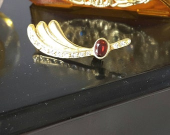 Gold Tone Wave Brooch with Clear and Garnet Red Rhinestones